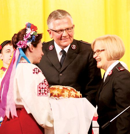 The Chief of the Staff and Commissioner Sue Swanson are welcomed with a traditional eastern European bread and salt greeting.