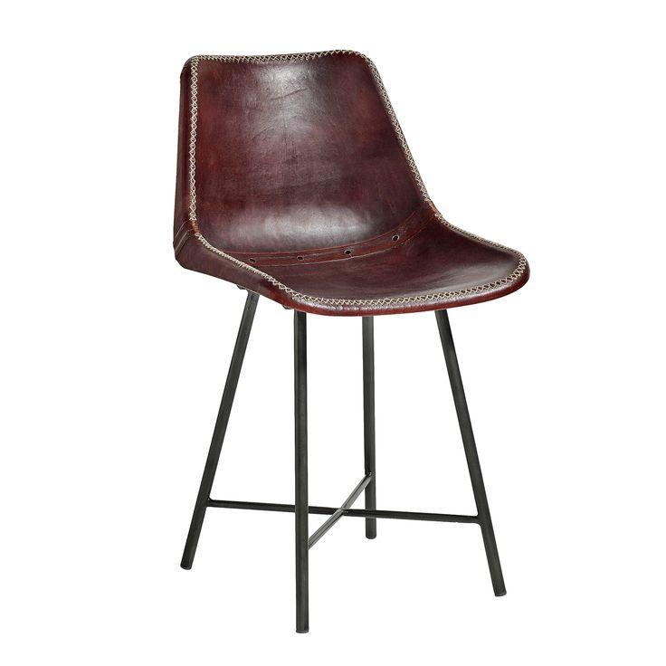 Stoer en Vintage! Deze bruine lederen eetkamerstoel van het Deense merk Nordal is echt een stoere design stoel!