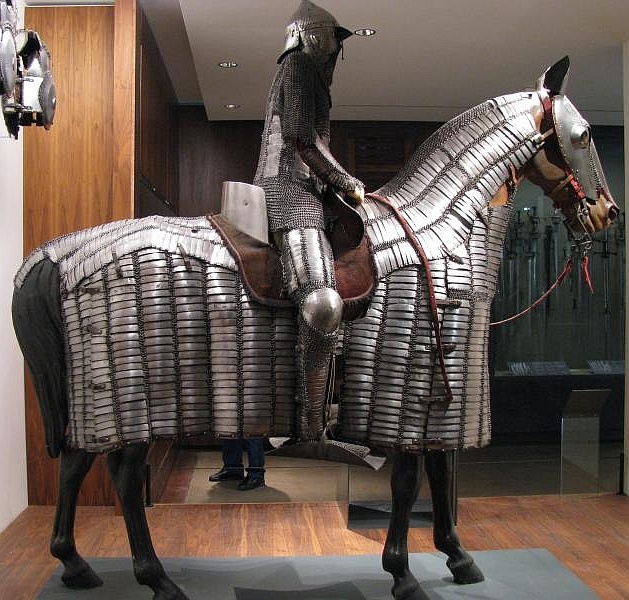 Ottoman mail and plate armor for horse and soldier; Circa 16th century. this type of armor became the standard equipment for the heavy cavalry under the Timurids (1370-1506), the Mongol successor empire which ruled from Samarkand, and under the Ottoman Turks. These cavalry, armed with bow, sword and sometimes lance, were the main component of all medieval Islamic armies. (Les Invalides Museum of Arms and Armor, Paris).