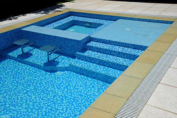 This swimming pool is located in Santa Fe, Argentina, and our #glassmosaics look so beautiful at night...