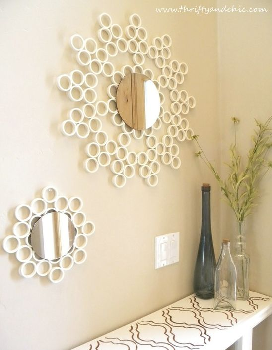 Upcycle Us: September 2011  Made with pvc piping.  Kind of cool, but it needs something else right around the mirror.....any ideas?  This would really pop against a darker colored wall.