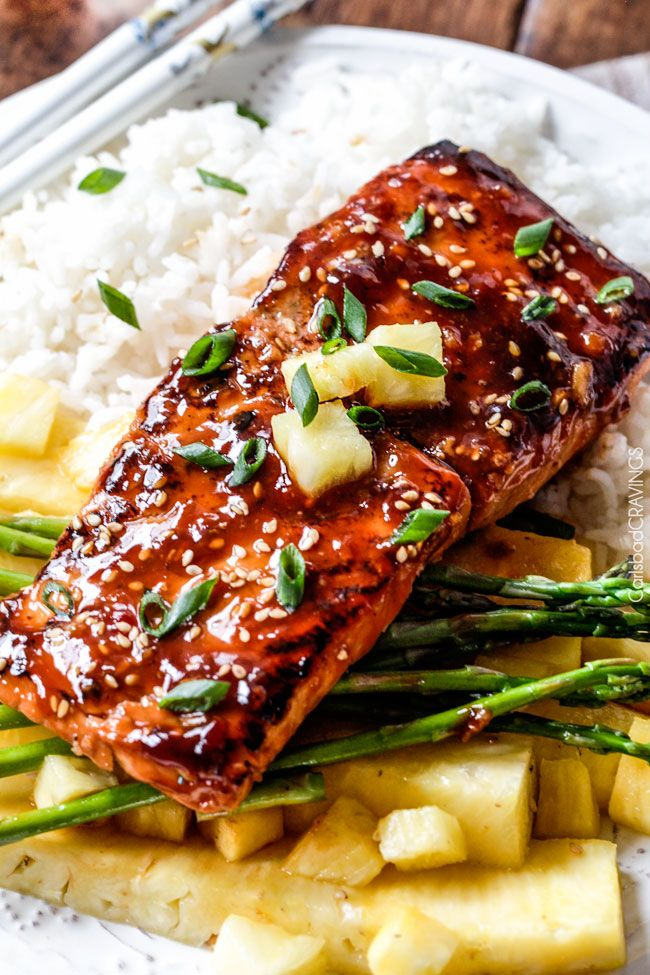 Sweet and Tangy Asian BBQ Salmon dripping with flavor from the most INCREDIBLE glaze but one of the easiest meals to put together!!