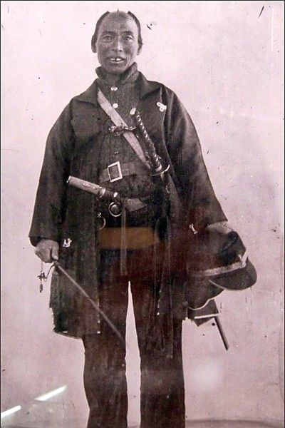 Samurai holding a muchi (whip) during the second Choshu expedition circa 1864-1865.
