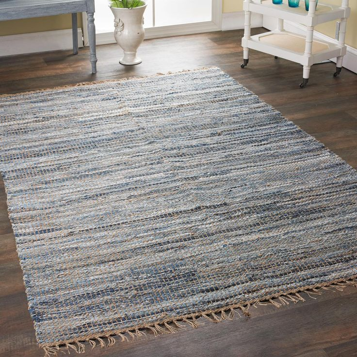 Denim and Rope Area Rug The perfect combination for chic rustic casual style, this area rug is woven from denim and natural jute. The blend of rescued cotton denim includes your favorite jeans color from faded blue to indigo, intertwined with rope tone jute and fringed ends. Hand woven