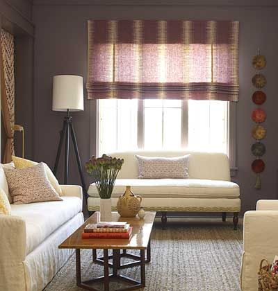 Amp It Up: Spice up a bold paint color, like dark eggplant, with funky art objects and bold window treatments, but keep large pieces of furniture simple to balance the space.