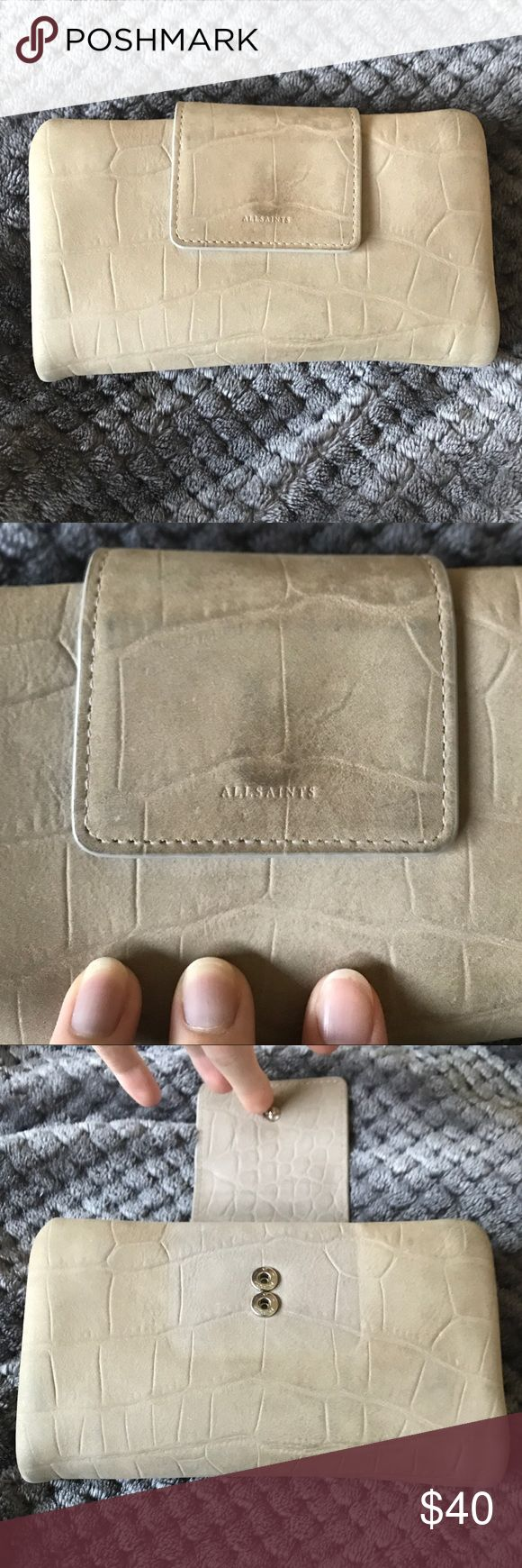 All Saints Paradise Wallet Taupe pebbled suede bi-fold with detachable coin wristlet for a more compact wallet. 9 card slots. Note the discoloration on the front near embossed logo and underneath the cover. Priced accordingly! No trades. Happy to answer any questions. Height: 10cm. Width: 18cm. All Saints Bags Wallets