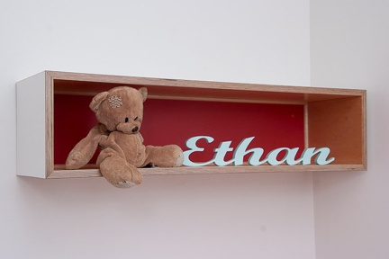 Custom made timber name plates are a great way to personalise a child's space.  http://www.kidsindesignedspaces.com.au/residential/juniorproject1