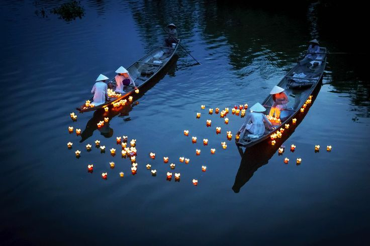 Praying #boat #people #candle #hue #huong #floating #dead #river #pray The girls in Ao Dai dresses (traditional dresses) in Hue city (Central of Vietnam) were dropping the floating candles on the river to pray for the dead people. It's a traditional manners of Vietnamese people. -- Your Shot. NATIONAL GEOGRAPHIC
