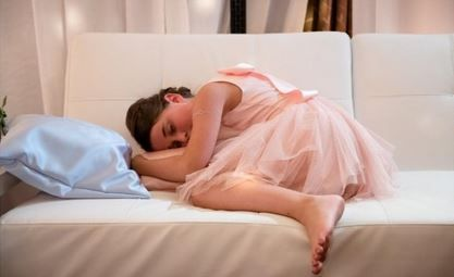A lovely Flower Girl Resting up on one of our pillows. Functional and an easy way to add a little color and texture to your next event.