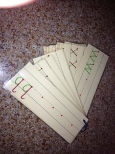 Laminate sentence strips for handwriting practice. Used different colors for the different strokes and placed a dot at the correct starting point.