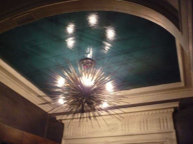 great way to add color~paint only the ceiling in the dining room area