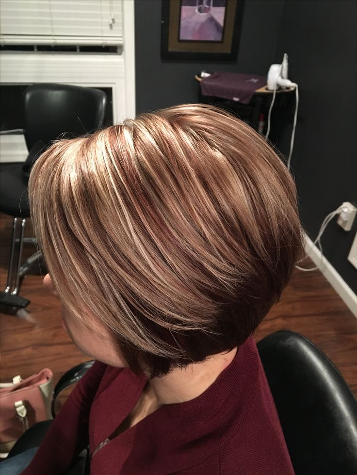 Auburn back with auburn lowlights and frosty blonde highlights. Done by Lindsey Honzles