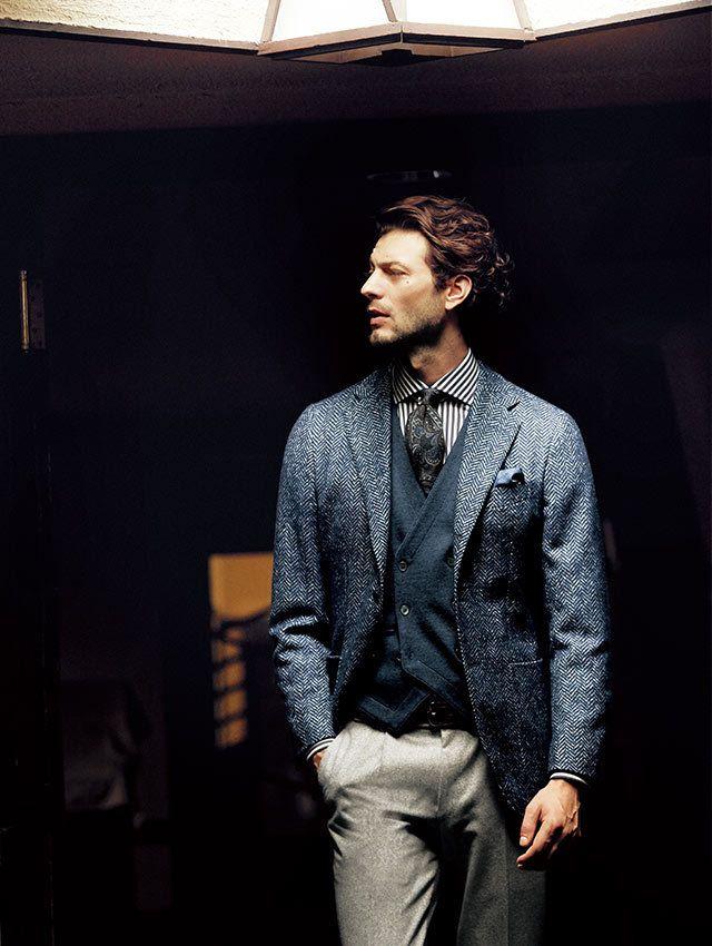 Love this fall look! Blue herringbone jacket, stone trousers, navy waistcoat, striped dress shirt and dark paisley necktie