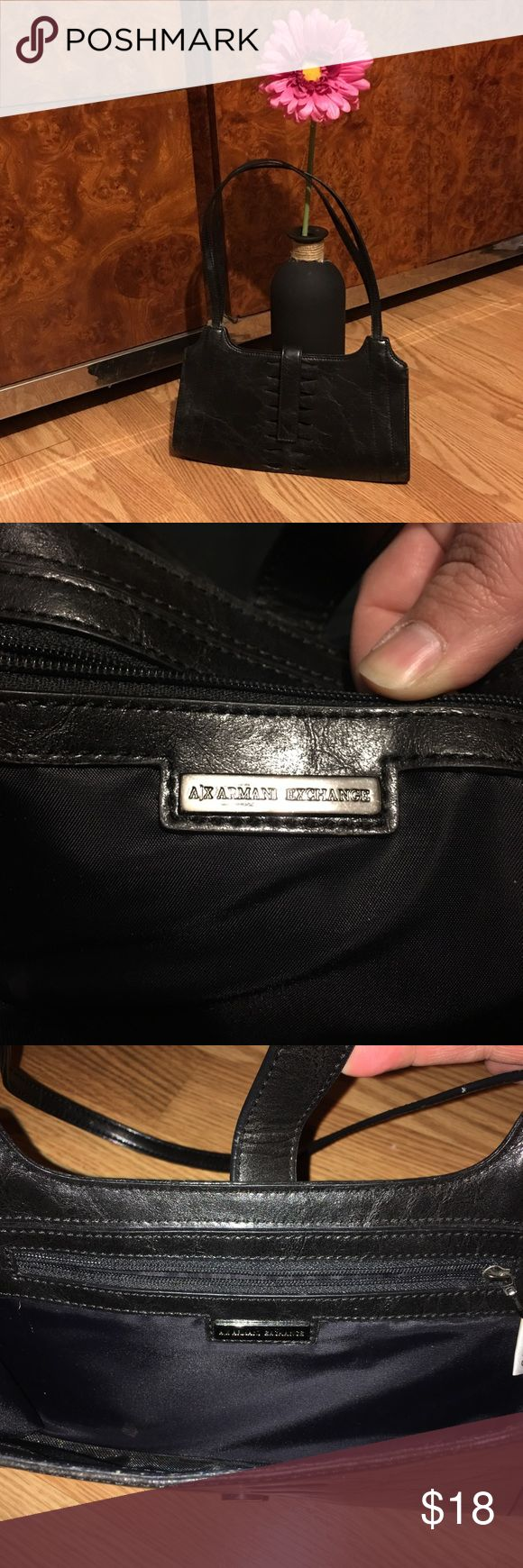 Armani Exchange Purse Small Armani Exchange purse 11' long, in good condition, has a few white spots on the back and a spot on the inside of purse as shown in pictures A/X Armani Exchange Bags Shoulder Bags