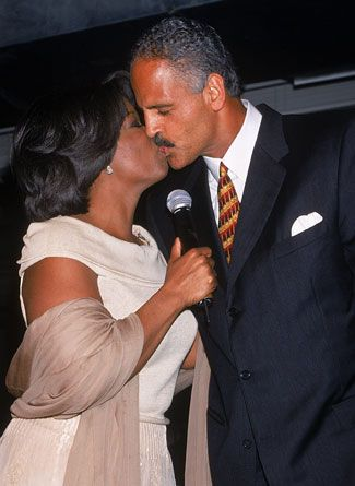 I absolutely love this pic. Oprah and Stedman sharing a, publicly, intimate moment...DLinder