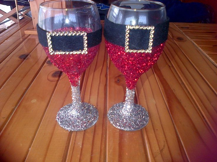 Two wine glasses, some modge, glitter, felt and buckles clear coated with glitter clear lacquer for a pretty Christmas table candle holder.