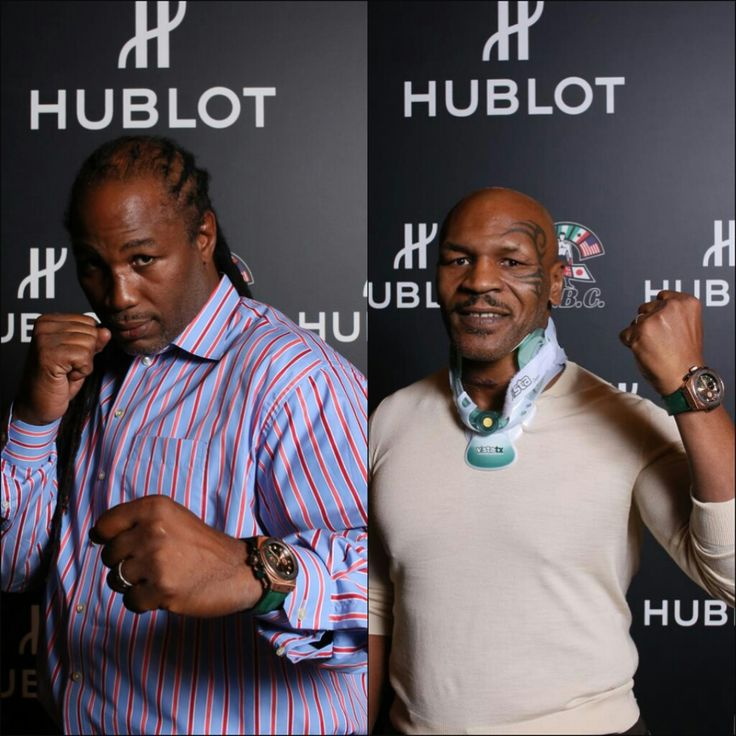 Lennox Lewis and Mike Tyson pose with their timepieces#chronowatchco