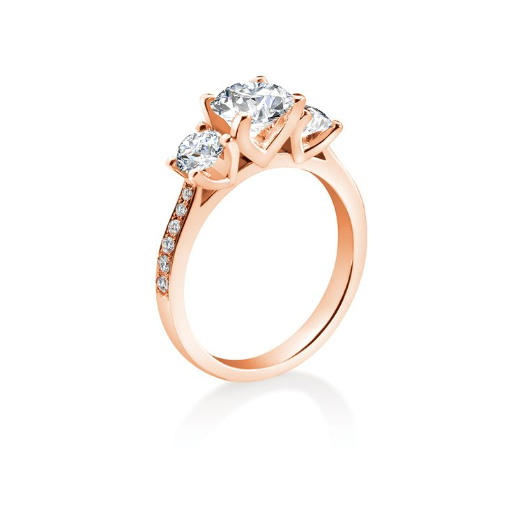 A gently tapering band with delicate pave-set diamonds leads the eye to a classically proportioned trio of fine brilliants embodying the everlasting symbols of spirit, heart and mind.  Starting from $1499