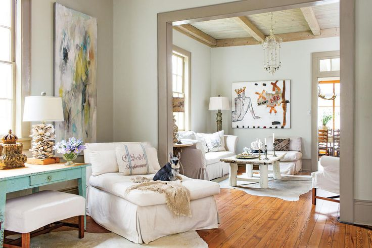 "Layer Neutrals for a Relaxed Look - 108 Living Room Decorating Ideas - Southernliving. ""To give Country French my minimalist spin, I avoid the expected ruffles and plaids and keep it about the painted antiques and white linens,"" says homeowner and designer Regina Lynch. ""In this house, curtains would have been too much, so instead I painted the trim a dark gray for a similar, but cleaner, look."""