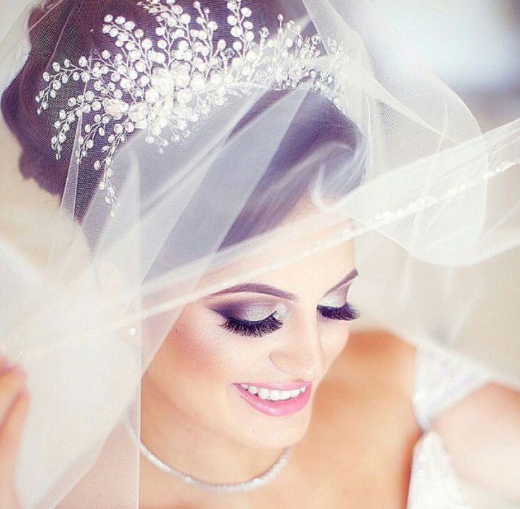 Dramatic bridal makeup Headpiece by bridalstylesboutique