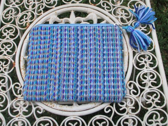 Hand embroidered jute clutch  with wool  in blue and by Apopsis