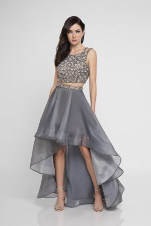 d28919f8b7 The high-neck crop top of this two-piece dress features allover floral  beading and tank straps that split at the back. The flowing high-low  organza skirt ...