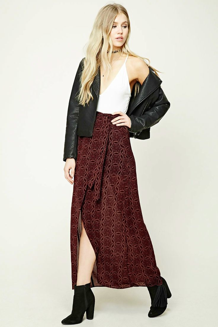 A woven maxi skirt featuring a tulip hem, an allover abstract medallion print, a knit mini skirt underlayer, a side-tied waist, and a concealed side zipper.