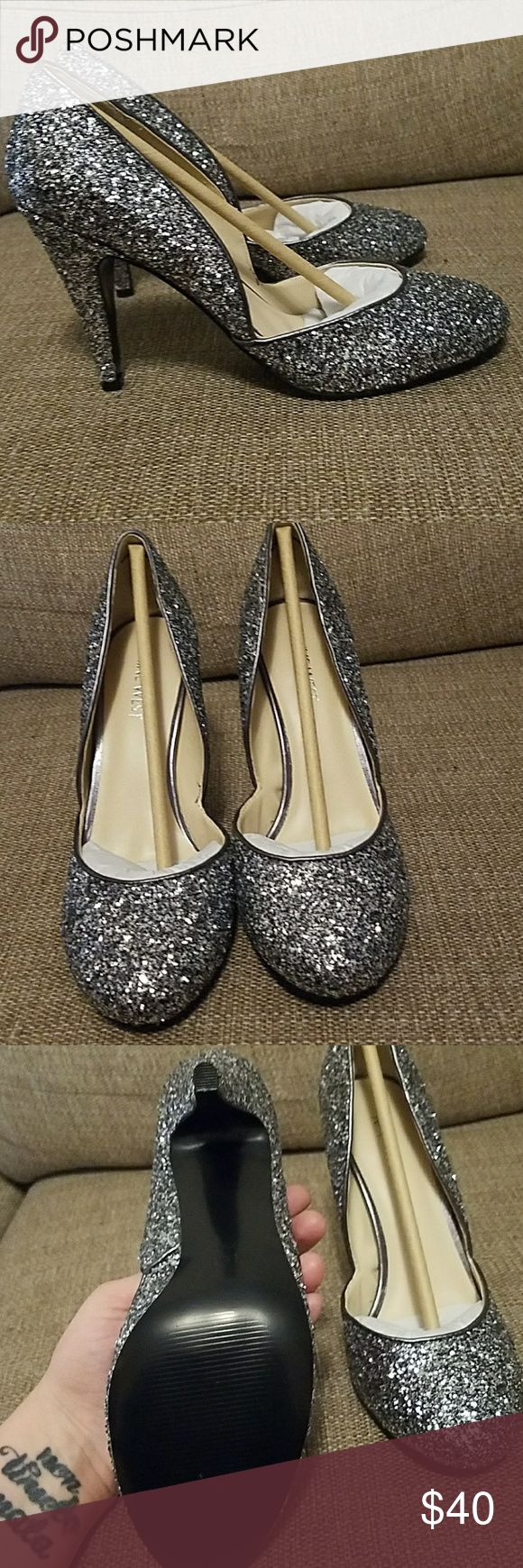 """NWOB Nine West silver glitter heels Very fun and flirty 4"""" silver glitter heels from Nine West. Never worn, I wish I had an occasion to wear them! These are perfect for a party or everyday for the bold! No box, I live in a one bedroom apartment and threw out the box to save space. I am also unsure if they are real leather or not. Nine West Shoes Heels #GlitterHeels"""