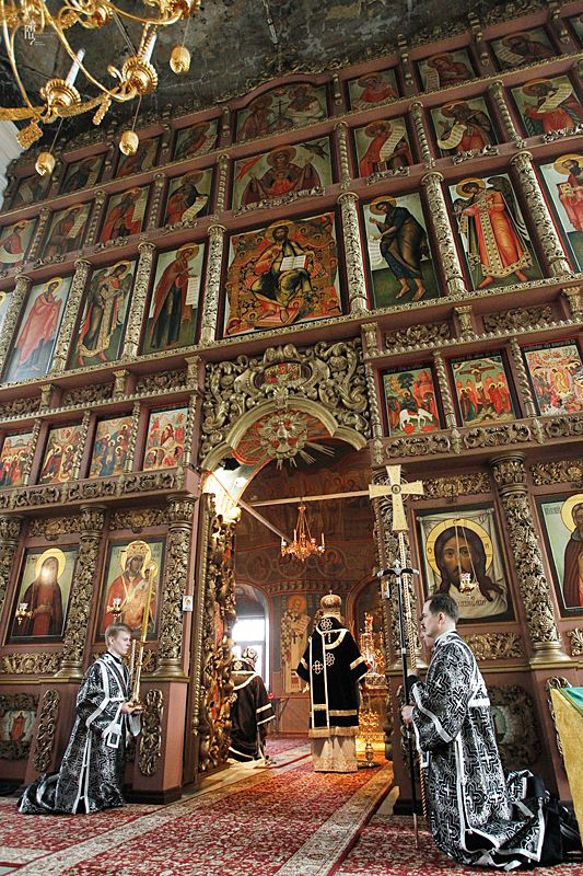 Icons adorn the walls inside a Russian Orthodox church.