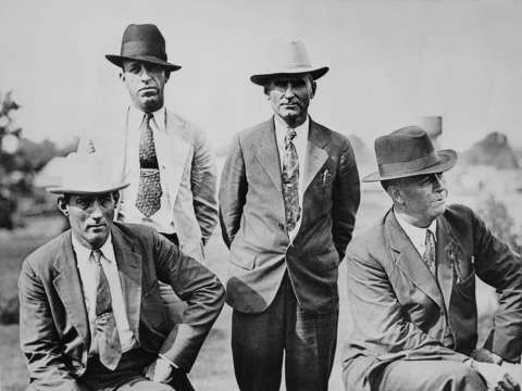 Four members of the six-man posse who ambushed and killed Clyde Barrow and Bonnie Parker are seen near Gibsland, La., on May 24, 1934, the day after the deadly ambush. From left to right: Dallas County Sheriff's Deputies Bob Alcorn and Ted Hinton and former Texas Rangers B.M. 'Manny' Gault and Captain Frank Hamer. Photo: FPG, Getty Images / 2010 Getty Images