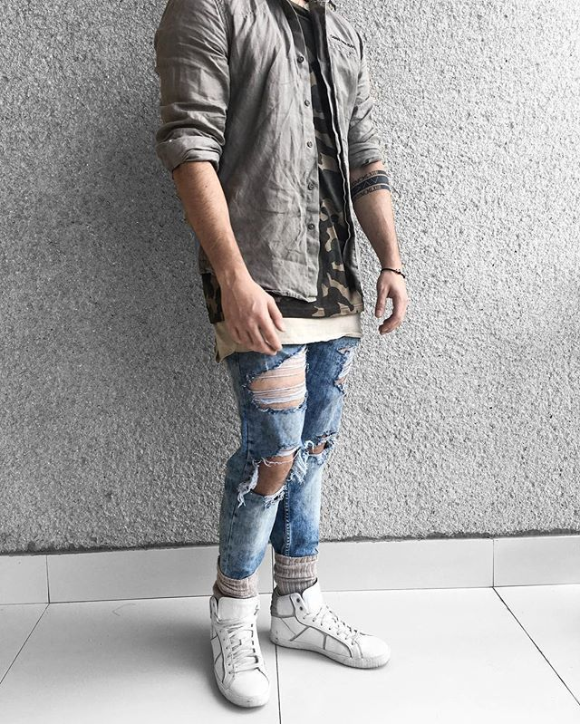 Creamy and camo layers with distressed denim