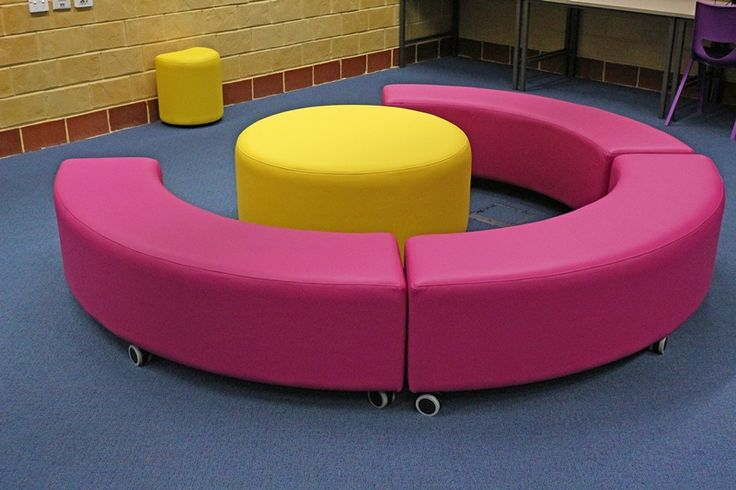 Create a separate reading area with curved and round ottomans.