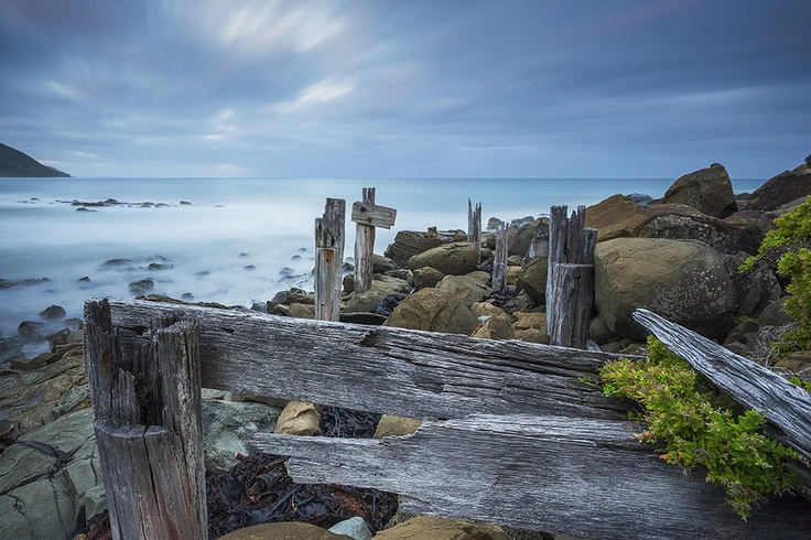 An old logging jetty slowly succumbing to the relentless Southern ocean. Wye River, Great Ocean Road, Victoria, Australia.