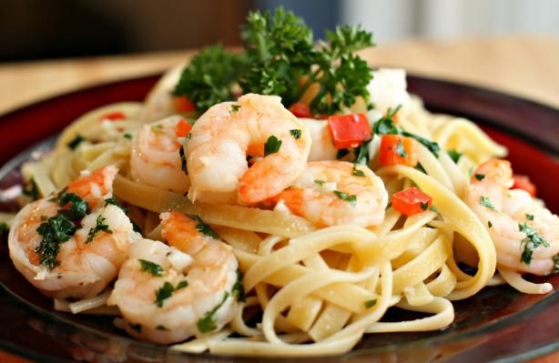 V s Shrimp Fettuccine from Food.com:   My kids love shrimp... however, my husband is not a big fan, so when he has to work nights, this is a treat for the rest of us. This is a simple and delicious recipe.