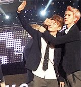 """Chen is like """"let's wave to the people."""" and Sehun is like """"no. love me."""""""