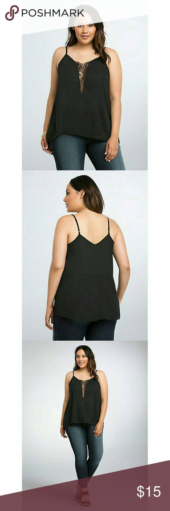 "Lace Inset Cami Top A little bit lingerie-inspired, this itty-bitty black georgette cami top is redefining the lace genre. With sheer lace insets under the arm and down the deep v-neck, this very sexy cami guarantees that whole ""drop jaws, turn heads"" effect.     Model is 5'10, size 1      Size 1 measures 25 3/8"" from shoulder     Polyester     Wash cold, dry low     Made in USA plus size top torrid Tops Camisoles"