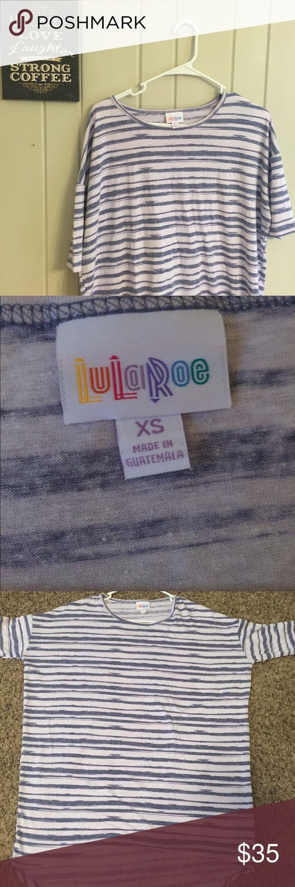 XS LuLaRoe Irma XS LuLaRoe Irma tunic top. Brand new without tags. Made in Guatemala. Super cute with leggings or skinny jeans. Adorable striped pattern that would be cute with almost anything! LuLaRoe Tops Tunics