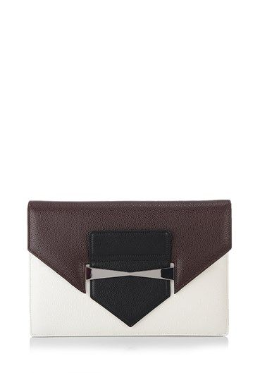 Rigid structure #clutch by #AlexanderMcQueen in brown, black and white leather panels with 'Legend' detail in silver metal. http://bit.ly/1jY80zF