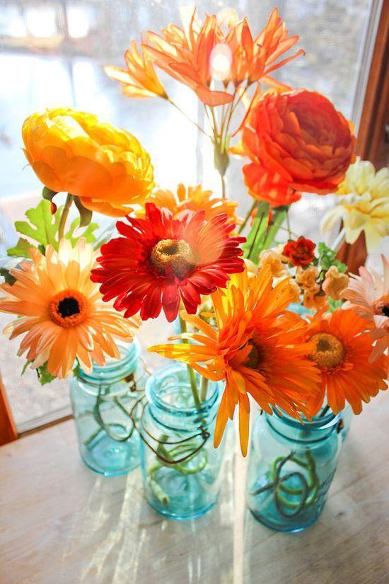 Vintage mason jars with orange flowers
