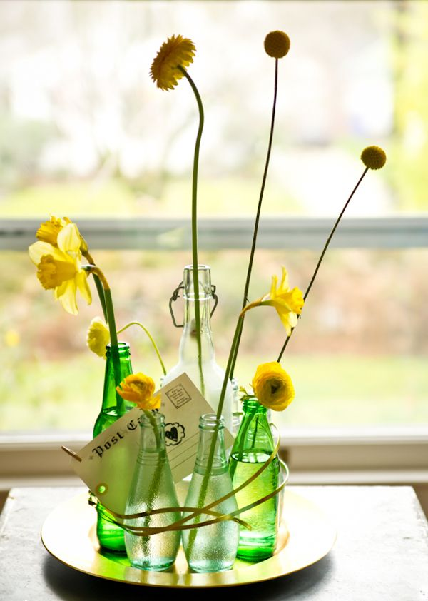 Go Green: Up-cycled Bottle Arrangements | Photo by http://ericaannphotography.com Floral design by http://geraniumlake.com