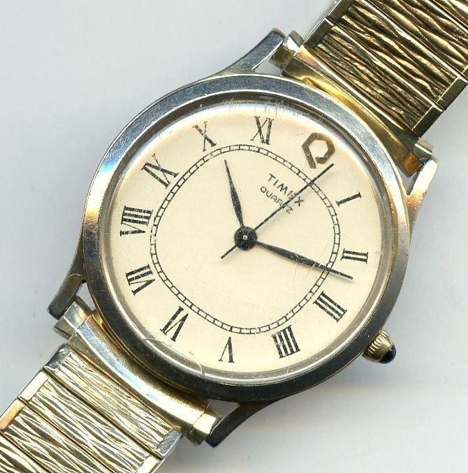 Vtg Timex Q Water Resistant M Cell Quartz Gold Tone Off Wht Dial Mens Watch -TLC #Timex #MCell