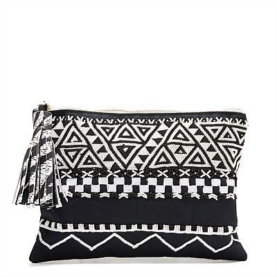 Designed in Melbourne, created in Kenya, the Afrigraphico Pouch incorporates traditional Maasai hand-beading and artisan silk-screening with a futuristic, geometric pattern and motif hand-sketched by MIMCO designers. @ethicalfashion1 #mimco