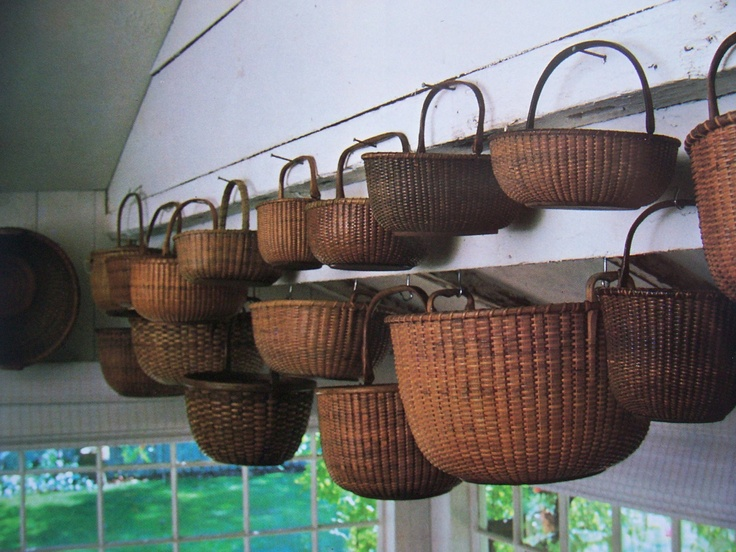 Old  Baskets...hanging from nails.