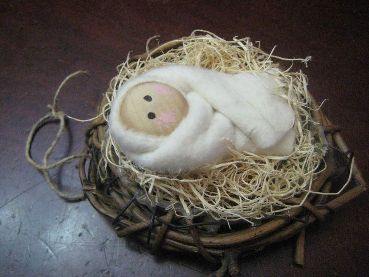 Christmas Ornament: Baby Jesus in Swaddling. Base is a small grapevine wreath to which a piece of twine is attached for the hanger. Picture only. You have to figure out how to make it, unfortunately.