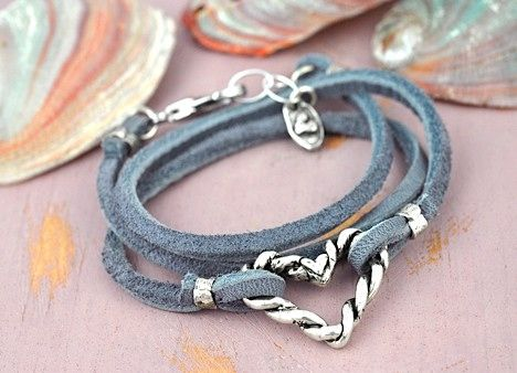 Twisted Heart - Boho Wrap bracelet  Our newest boho wrap bracelet! A twisted heart is anchored in the center of a gun metal grey soft leather lace that wraps around the wrist three times…  #bracelet #heartjewelry #heartbracelet #leatherbracelet  islandcowgirl.com