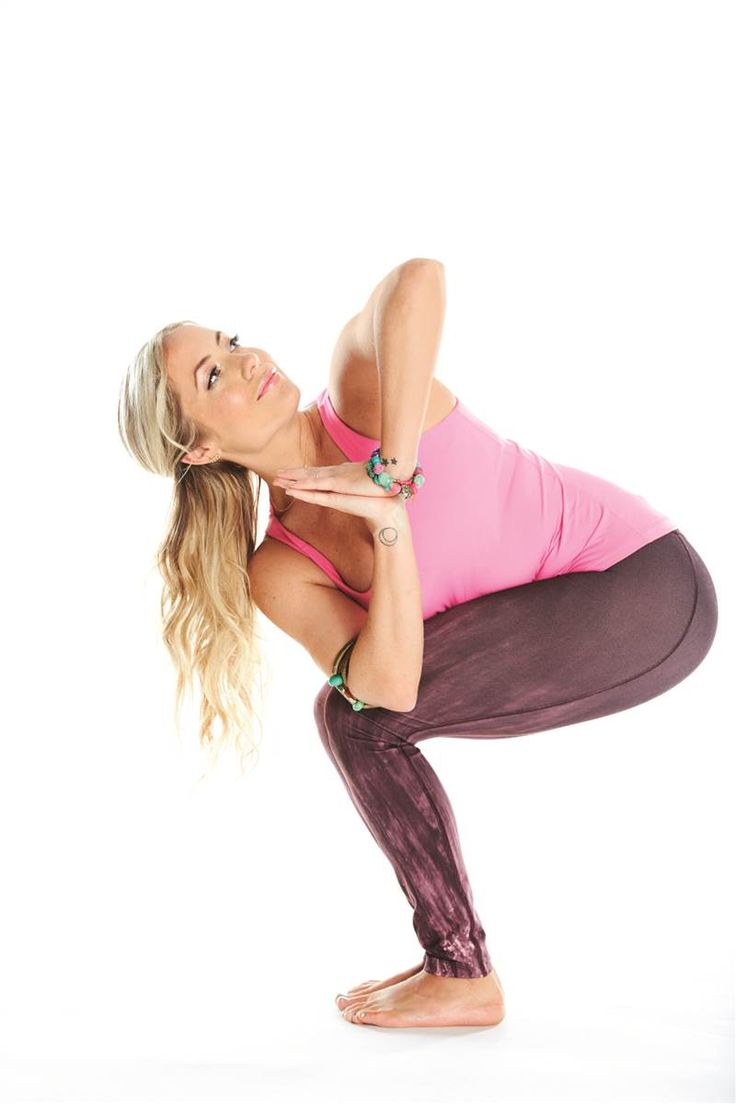 Yoga to overcome midday sluggishness. Kathryn Budig demonstrates the chair pose twist