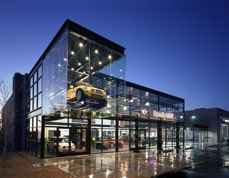 I guess people who LIVE in glass houses...should fill it up with nice cars!