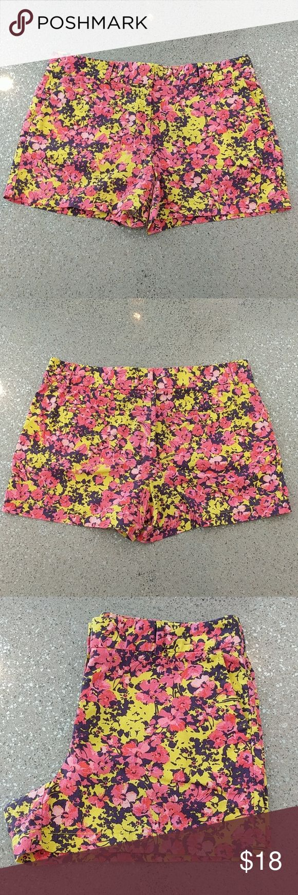 """Ann Taylor LOFT women's floral shorts size 12 Ann Taylor LOFT women's shorts - pattern is bright floral with yellow, purple, pink, salmon and orange. Has a wonderful soft linen feel, fabric is 55% linen, 45% cotton. size12. Side seam measures 14"""" long. Waist is 18.5"""" across. Gently worn, impeccably cared for... LOFT Shorts Bermudas"""