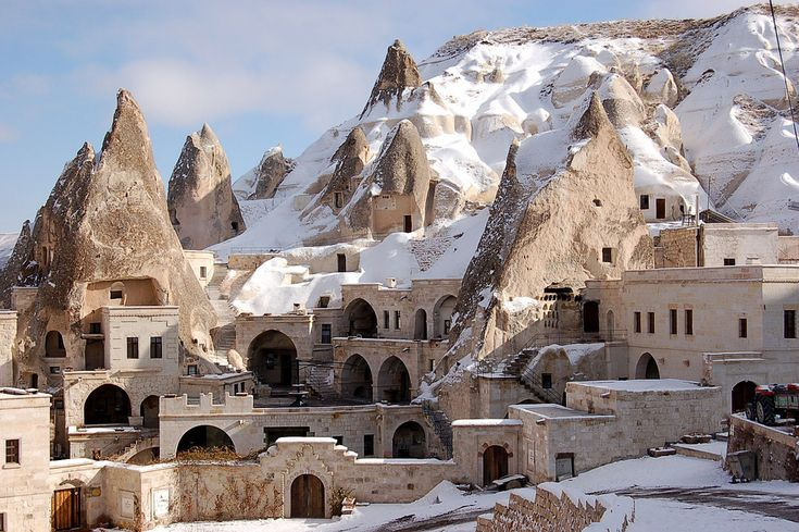 """The region of Cappadocia (Capadokya) is located in central Turkey, and is the setting for one of the strangest landscapes in the world. The deep valleys and soaring rock formations are volcanic rock formations, slowing eroding away to create the strange """"Fairy Chimneys"""" (so called because locals thought they were so magical and extraordinary that only fairies could have created them). Many of these fairy chimneys have been hollowed out by industrious ancient people, who created homes…"""