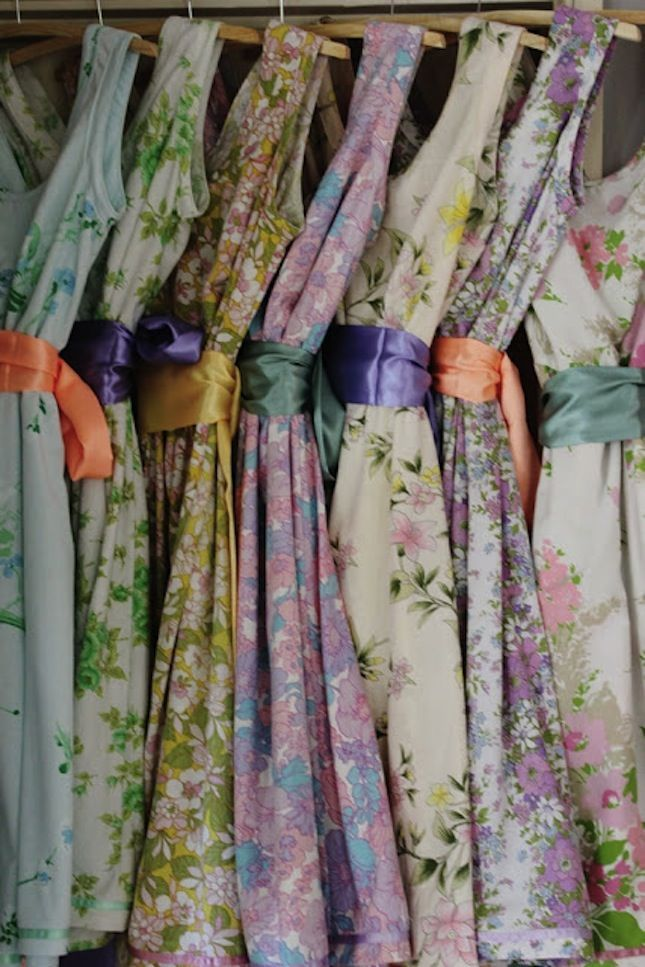 Flowers and Ribbons: Find an assortments of floral vintage dresses that are similar but not exactly the same. Then add different color ribbons onto each dress to differentiate them even more.